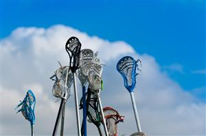Lacrosse sticks held up in the air